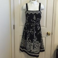 """Ready for Summer Scrappy Dress Black White floral EGUC Really cute Black Dress with White Floral Design Tie Belt  1"""" Straps Zipper Back Cotton spandex Size 8 Please see all pictures as they are part of the description  Ask any questions before purchase  Shipped and stored from non-smoking home #361 Madison Leigh Dresses"""