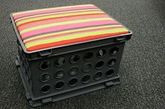 Turn storage crates into seats! This would be great for reading centers!