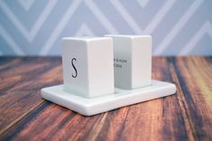 We love these personalized salt and pepper shakers from Susabellas. Great for an engagement or wedding gift.