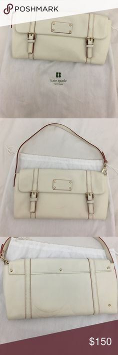 Kate spade Clutch and purse has never been used but the red lining has rubbed off on some of the white kate spade Bags