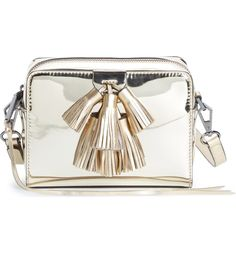 Steal the show with this glossy metallic crossbody bag by Rebecca Minkoff featuring an optional, adjustable strap and an abundance of playful tassels.