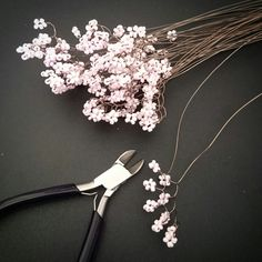 Pink wire and bead tree in progress. Handmade by twystedroots