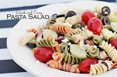Quick And Easy Pasta Salad - cherry tomatoes - large cucumber - red onion - olives - mozzarella cubes - garlic salt - 2 - 16 oz. packages tri-colored pasta - 16 oz. bottle Paul Newman's Italian Style Salad Dressing