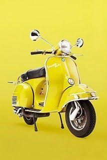 Bright Yellow Vespa Motor Scooter