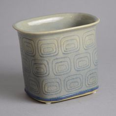 Christian Poulsen, own studio, Denmark Earthenware rectangular vase with impressed pattern to body and glossy pale blue crackle glaze. Painted Width 5 More items by Christian Poulsen