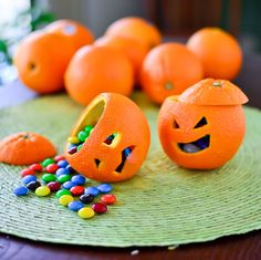 Just cut around the edges of the orange and scoop out the fruit. Carve some eerie faces and finish off by filling with your favorite candy. #Halloween