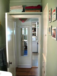 Like this idea for building storage over a door, especially in the bathroom
