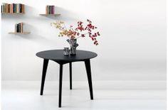 Billede af det sorte og runde spisebord Osso Eg Blackstone.