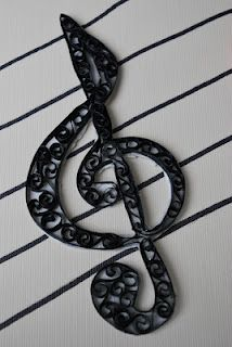 Quilled treble clef...