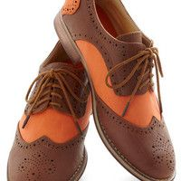 brown and orange oxfords