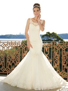 Wiress features rich allover lace highlighted with delicate appliqués and glittering hand-beading with a soft mermaid skirt that flares into a chapel length train. A sweetheart décolletage is cleverly disguised by a lace bateau neckline. A gently curved open low back neckline with zipper closure and covered buttons will leave your groom wanting more. Sizes: [...]