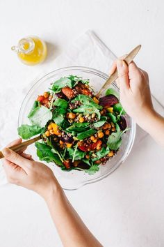 This Winter Beet & Grapefruit Baby Kale Salad with chickpeas, quinoa, and pepitas will be the hit of your holiday party! #vegan #salad #kale | Brewing Happiness | Pinned to Nutrition Stripped | Salad