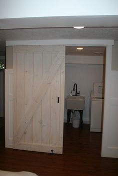 Sliding Barn Door.........Uses exterior tongue and groove siding for door and closet track or pocket hole door hardware.