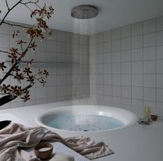 modern bath: rain-fall style shower suspended over circular tub