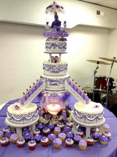 Purple Quinceanera cake and cupcakes