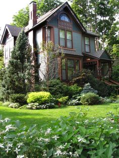 When working with a house as beautiful and detailed as the home shown here, the landscaping can be as simple or as ornate as you like. Evergreens are a good choice for year-round landscaping. Design by HGTV fan babycates
