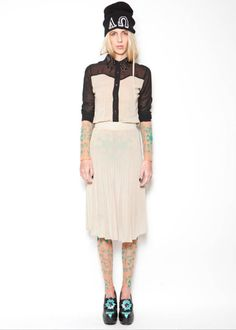 Sheer shirt and skirt worn upon tattoo top and collant