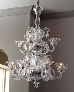 This elaborate blown-glass chandelier with intricate floral and foliage designs is inspired by the Murano glass chandeliers popularized in the 1920s and 1930s. Imported.