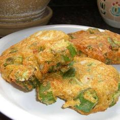 """1 lb fresh okra or 1 (18 ounce) bag frozen cut okra 1/2 cup onion (chopped) 1 teaspoon salt 1/4 teaspoon pepper 1 large egg 1/2 cup water 1 teaspoon baking powder 1 pinch garlic powder (potional) 1/2 cup flour 1/2 cup cornmeal oil (for frying) Combine cut okra, onion, salt, pepper, water and egg. Mix well. Combine flour, baking powder, cornmeal and garlic powder. Add to okra mixture, stirring well. Drop about 1/4 cup portions into about 1/2"""" hot oil. Fry over medium heat until well browned…"""