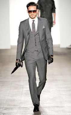 Love the suit + patterned tie