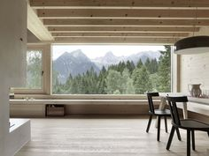 The 'House in Tschengla' looks out over a small village and across the mountains of Austria. Designed by Innauer-Matt Architekten, the home was built to provide a place of calm away from the chaos of the city.