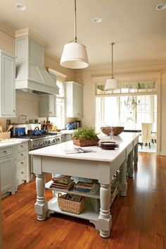 Kitchen with pale aqua cabinets, and creamy beige walls - Southern Living House Plan #1426, Captain's Watch - (Coastal Living 2007 Idea House http://www.coastalliving.com/homes/idea-houses/2007-captains-quarters-idea-house-00414000076687/ ) #beachy