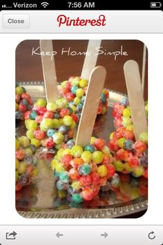 "Hungry caterpillar pops. Trix on a stick  Made like Rice Krispie treats.  These do look like the rainbow ""gravel in the book...maybe I could just sprinkle Trix like confetti on the food table?"