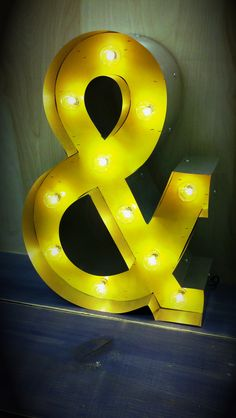 Hollywood Lighted Ampersand in a fun, Bright Yellow