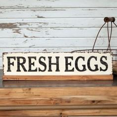 "Add a little vintage charm to your farmhouse kitchen or breakfast nook with this vintage inspired wood sign featuring ""Fresh Eggs"" in black letters on a white background. Measures x Antique Farmhouse, Farmhouse Signs, Farmhouse Decor, Chicken Coop Decor, Chicken Wire, Chicken Coops, Wine Signs, Garden Signs, Painting Wallpaper"