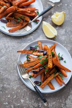 "Moroccan Spiced Roasted Sweet Potatoes and Carrots // Sweet potatoes and carrots are cut thinly into ""fries"" and tossed in a mixture of coconut oil kicked up with Moroccan spices like cumin, coriander and garlic. Carrot Recipes, Healthy Recipes, Vegetable Recipes, Whole Food Recipes, Vegetarian Recipes, Cooking Recipes, Blueberry Recipes, Roast Recipes, Delicious Recipes"