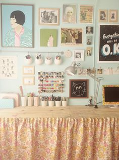 I'm working on a wall in my craft room that will hopefully end up looking similar to this. Picking up tiny prints and different artsy things from artists I love and hanging them where I work for inspiration and motivation.
