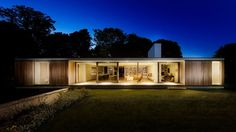 The Quest Swanage UK by Strom Architects /  FASHION EDITORIALS  TITRE & CLIENT  The Quest Swanage UK by Strom Architects  DATE DE PUBLICAATION  23 February 2017   11:58 am  EDITORIALS  From The Architect: The sloping site  with protected mature trees  very much dictated the positioning of the dwelling. Access is via the front of the property so we made use of a retaining wall faced in local Purbeck stone to define different levels and visually mask the vehicular route maintaining a clear…