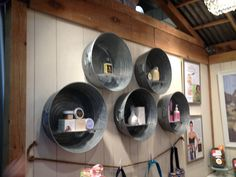 Washtubs on wall with shelving. Cute for bath and body. Use on suspended antique door?