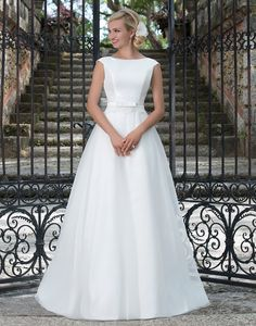 Sincerity brautkleid style 3897 A Mikado Sabrina neckline and organza A-line ball gown inspired by Audrey Hepburn's timeless style. A grosgrain belt with a bow accents the waistline to complete this simple and classic look.