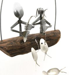 Silverware Man Fishing with sterling silver plated spoon fish swimming beneath. Rustic Masculine Fishermans Boat sways gently in the breeze. Unique Gift for any man or woman. Delightful charming spoon man fishing atop a natural driftwood dingy. Hanging beneath a school of spoon fish playfully swims in the breeze. Makes a perfect Christmas Gift For any fresh or saltwater angler. Men can be customized to suit your needs. We have both genders in adult & childrens sizes. If different sizes…