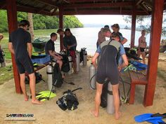 Instructor Tim supervises student divers at the hut to properly assemble their dive gear :)