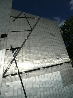 The new Jewish Museum celebrates Jewish life and the challenges Jews have faced over the years. The new building was designed by Daniel Libeskind, whose Freedom Tower may someday go up at the WTC site. The voids in the exterior represent pieces of Jewish culture lost by the Holocaust.