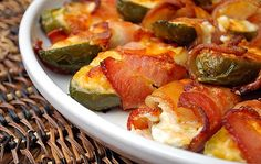 Bacon Wrapped Jalapeno Poppers -  Cut jalapenos in half lengthwise and remove seeds. Fill with cream cheese and sprinkle top with cheddar cheese. Wrap 1/2 slice bacon around filled pepper and bake at 450 for 15 minutes or until bacon is fully cooked. Serve warm.