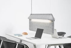 A Workspace Divider That Doubles as a Lamp