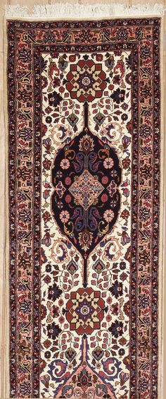 This beautiful Handmade Knotted Runner rug is approximately 2 x 19 New Contemporary area rug from our large collection of handmade area rugs with Persian Tabriz style from Iran/Persia with Wool/Silk