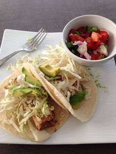 21 Day Fix Fish tacos - mahi mahi (1 red), spice (free), 2 corn tortillas (1 yellow), cabbage (1/2 green), onions and tomatoes (1/2 green), cilantro, garlic and lime juice (free), avocado (1 blue)