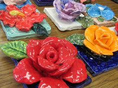 "Ceramic flower sculptures by my 4th grade students; 7"" X 7"" per sculpture; lesson by art teacher: Susan Joe"