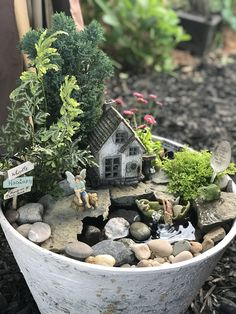 Forest themed fairy garden with water feature.