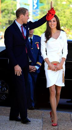 The recently anointed royal, 29, made a regal, sexy entrance in a cream, wrap-style dress by Reiss, featuring ruffle details and a collarbone-bearing neckline; Kate accessorized the snowy look with the Queen's Maple Leaf brooch, demure red pumps and a maple-leaf fascinator by Sylvia Fletcher at Lock and Co.