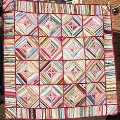 """""""Gleanings"""" selvage quilt by Shirley Sherratt from Taunton, Somerset, UK. It measures 65"""" x 65."""" She used only what she had in her stash, plus gleanings from her friend Val's stash. What are quilting buddies for?"""