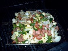 This is an easy, cheap, and delicious meal. Smoked sausage, mushrooms, green peppers, onions, and zucchini. Cook it in a grill basket to let the smoke flavors go through the food and use a vegetable grill spice on it. Nothing fancy as the ingredients and grill create the flavor.