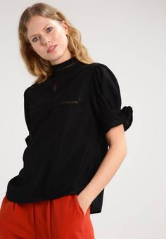 """DEVYN - Blouse - black. Outer fabric material:100% polyester. Fastening:button. Total length:24.0 """" (Size 10). Collar:Mandarin collar. Back width:14.5 """" (Size 10). Length:standard. Pattern:plain. Fit:regular. Our model's height:Our model is 70.0 """" tall and is wearing siz..."""