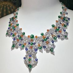 @realm_of_jeweller. Giampiero Bodino jewel is an expression of a spirit of the times. He creates unique masterpieces with no resemblance to anything else in existence. On the picture gorgeous necklace from Mediterranea HJ collection featuring vivid gems beautifully accentuated on the white gold arabesque construction, unveiled during Haute Couture Week at the Ritz in Paris. #realmofjewellery #giampierobodino #mediterranea #hautejoaillerie #savoirfaire #preciousgems #fireopals #emeralds…