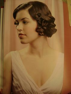 1920's hair. If I had the bone structure for a short cut, I'd do it.