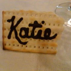 Passover place cards with matzah and chocolate